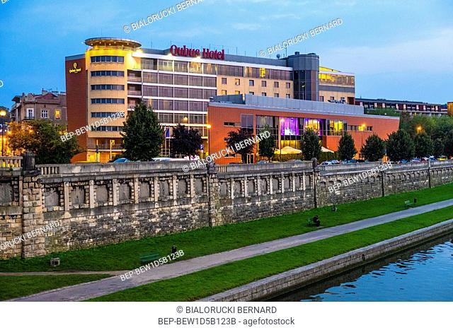 Krakow, Lesser Poland / Poland - 2018/09/08: Cracow Old Town, evening view of the Qubus hotel in the Podgorze district, by the Vistula river