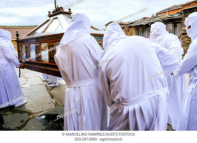 Holy week. On Good Friday, the cofrades are covered with a white tunic with hood that forms the mortuary with which they will be buried when they die