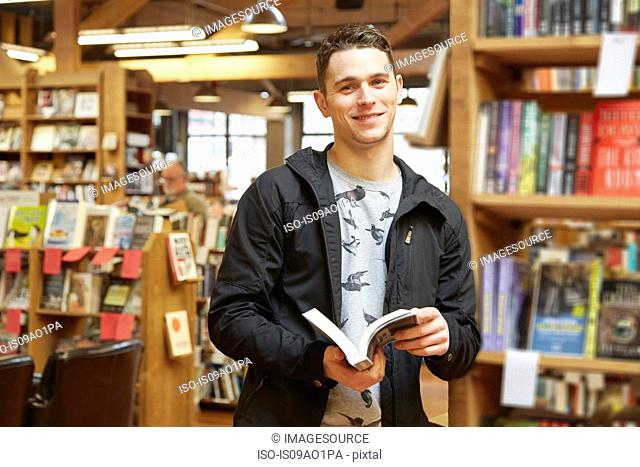 Portrait of young man in book store