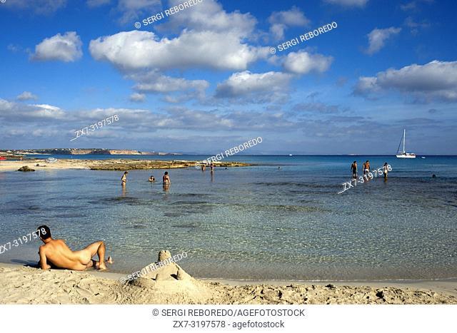 Man nucked in Ses platgetes beach in Es Calo de San Agusti, Formentera Island, Mediterranean sea, Balearic Islands, Spain. Can Rafalet Restaurant