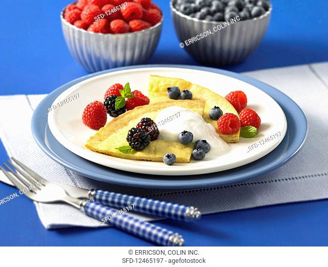 Dutch baby with orange flavor and berries