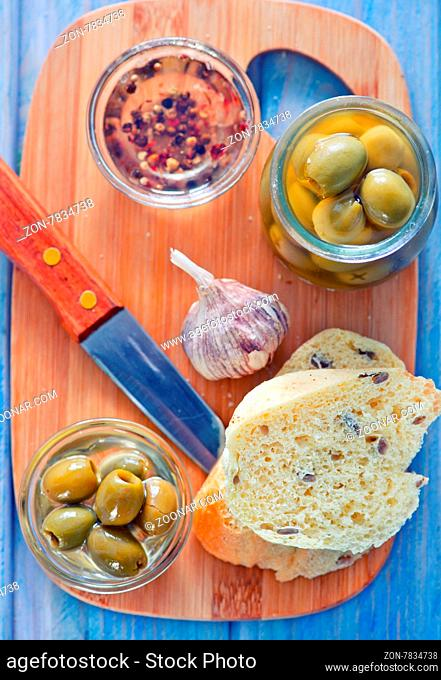 bread with olive and oil on the board