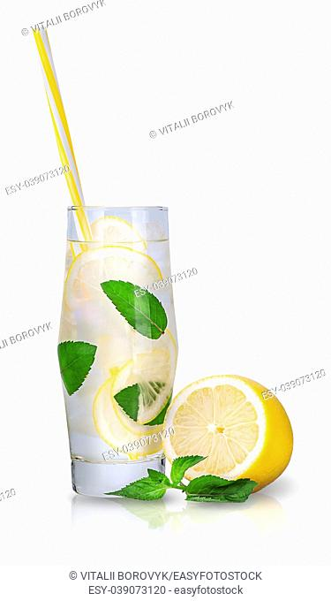 Lemonade with mint and ice. A sweaty glass with ice cubes and a tube for cocktails. Isolated on white background