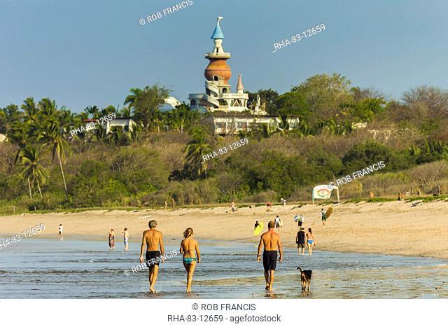 Walkers & the Nosara Beach Hotel at popular Playa Guiones beach, Nosara, Nicoya Peninsula, Guanacaste Province, Costa Rica, Central America