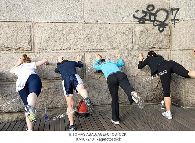 Brooklyn Bridge, New York City, Women streching before excercising