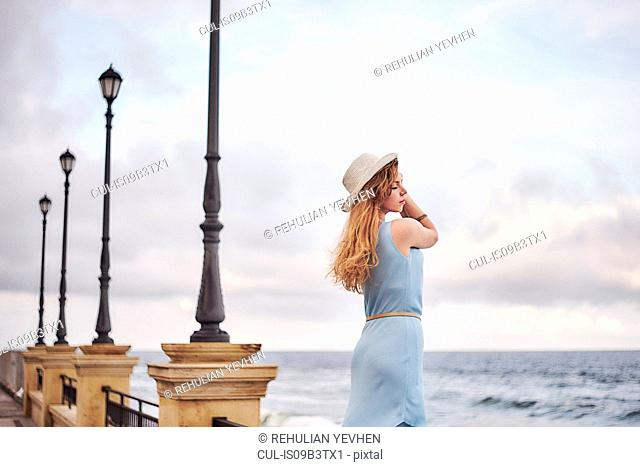 Woman looking out to sea