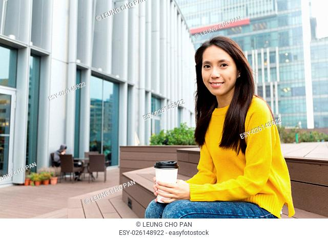 Woman hold a coffee cup at outdoor