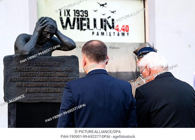 01 September 2019, Poland, Wielun: Federal President Frank-Walter Steinmeier and Polish President Andrzej Duda (l) lay down flower arrangements at the memorial...