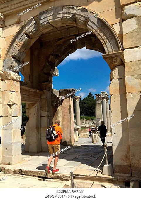 Tourist passing through to access from the library of Celsus to the Agora southgate of the Roman ruins of Ephesus, Efes, Selcuk, Kusadasi, Turkey, Europe