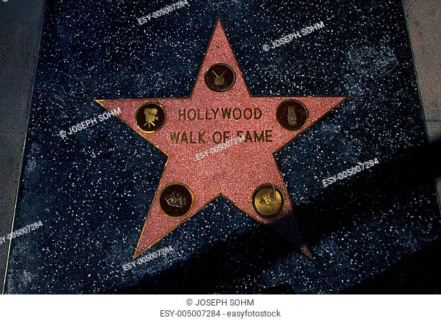 This is a star that says Hollywood Walk of Fame on Hollywood Boulevard. It is in Hollywood,