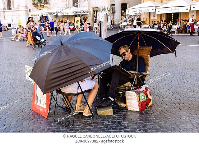Street painter working on a caricature of two girls in Piazza Navona, Rome, Lazio region, Italy