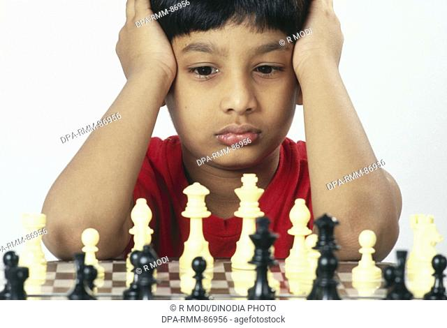 South Asian Indian boy playing chess MR152