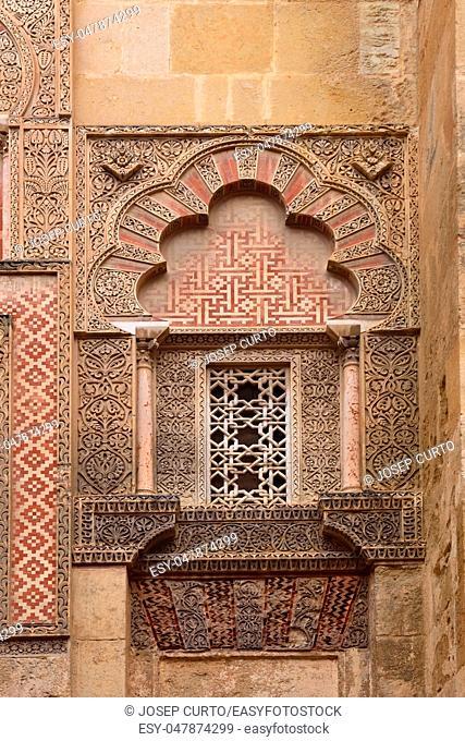 Door and facade of Espiritu Santo, Moorish facade of the Great Mosque in Cordoba, Andalusia, Spain