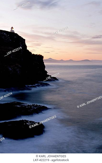 blocked for illustrated books in Germany, Austria, Switzerland: Taiaroa Head lighthouse on cliffs at dusk, twilight, Otago Peninsula, Otago, South Island