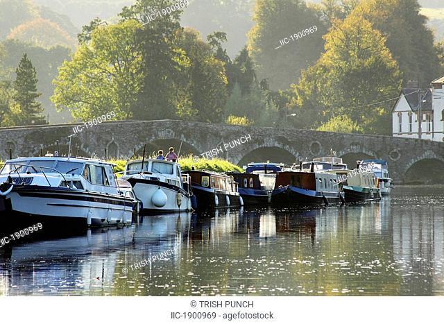 moored boats on the river barrow in leinster region, graiguenamanagh, county kilkenny, ireland