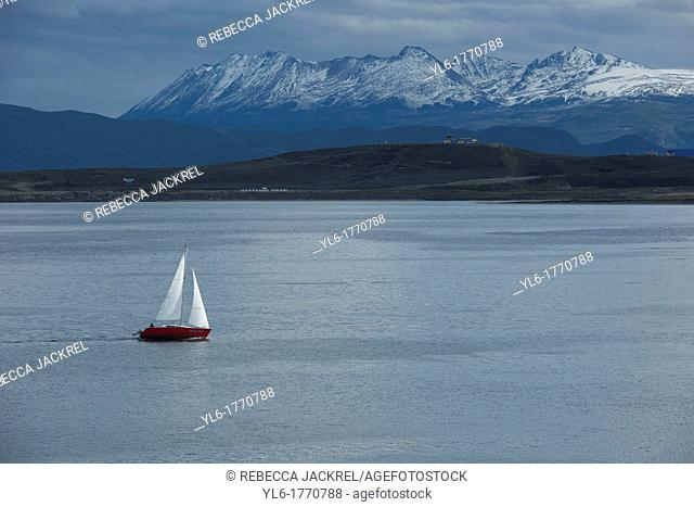 A sailboat plies the waters of the Beagle Channel, Tierra del Fuego, Argentina