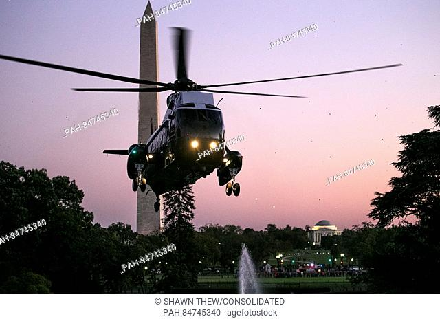 Marine One, with United States President Barack Obama aboard, flies near the Washington Monument comes in for a landing on the South Lawn of the White House in...
