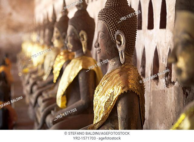 Ancient Buddha images line the courtyard walkway at Wat Si Saket in Vientiane, Laos