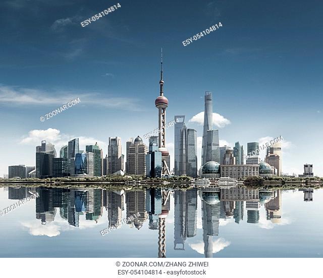 shanghai skyline against a sunny sky and reflection, abstract metropolis cityscape