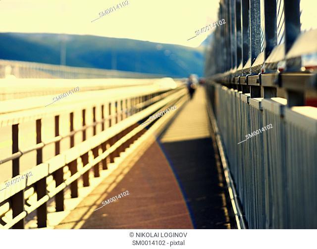Walking man on Norway bridge background hd
