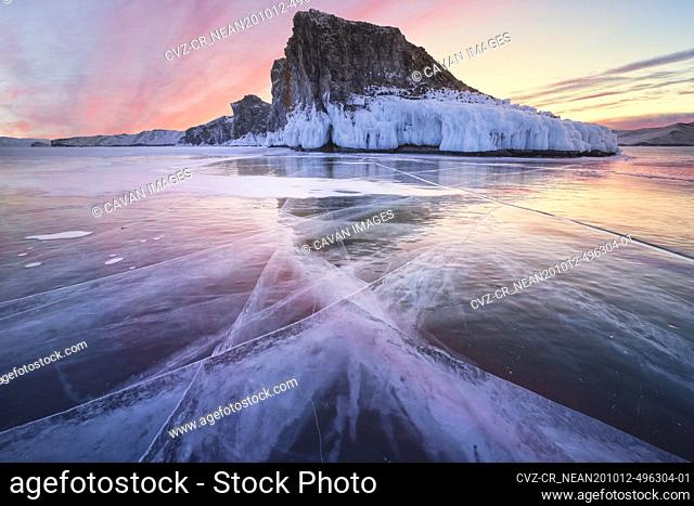 colorful sunset over clean ice in baikal lake