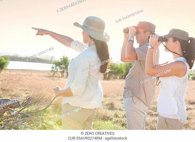 People using binoculars on a safari, Stellenbosch, South Africa