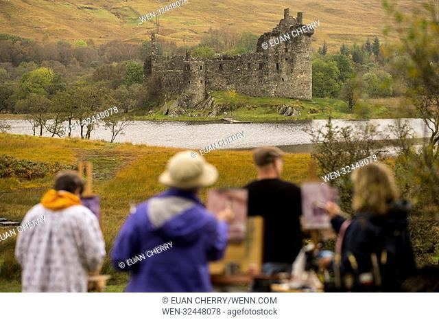A group of artists paint on site as autumn colours comes to Kilchurn Castle, located on a rocky peninsula at the northeastern end of Loch Awe