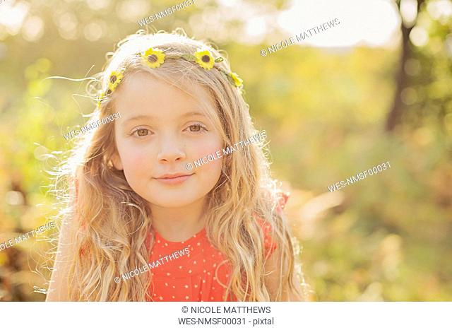 Portrait of relaxed little girl wearing flower wreath