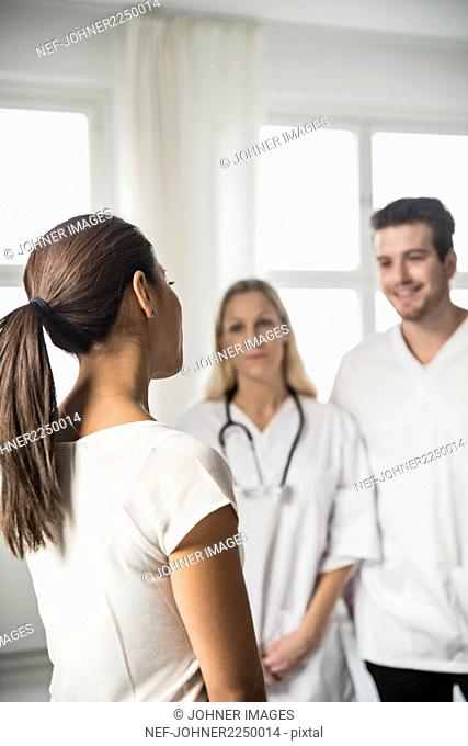 Woman talking with doctors