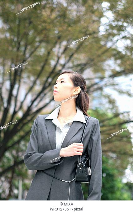 A young businesswoman standing