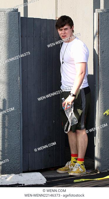 Evan Peters who has recently got engaged to Emma Roberts leaves for the gym wearing yellow sneakers and fun socks and also keeps his keys on a Spice Girls...