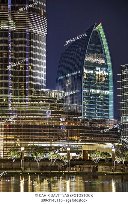 Boulevard Plaza Tower 2 designed by the Architects AEDAS and the Burj Khalifa designed by the architects SOM at twilight, Downtown Dubai, Dubai, Dubayy