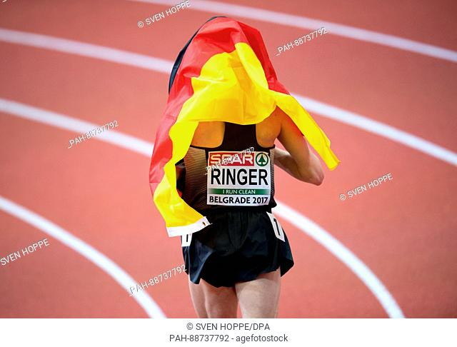 Richard Ringer from Germany (bronze) celebrates after the 3,000 m race at the European Athletics Indoor Championships 2017 finals in Belgrade, Serbia