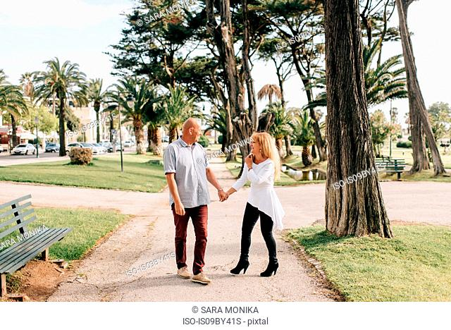 Couple taking walk in park, Estoril, Lisboa, Portugal