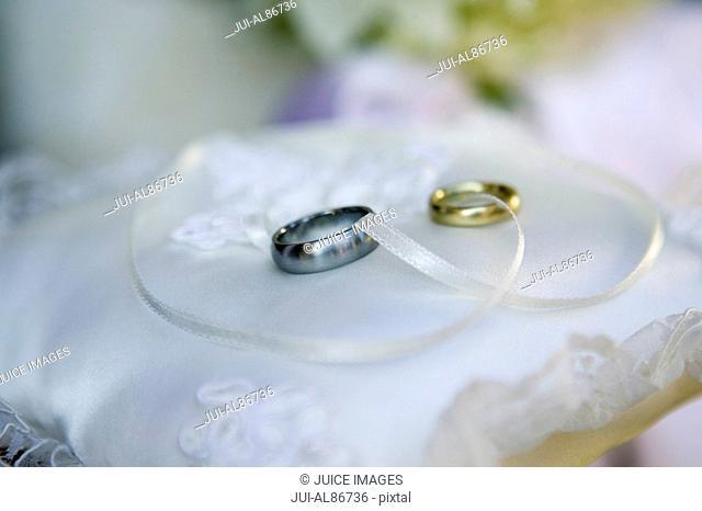 Wedding rings on pillow
