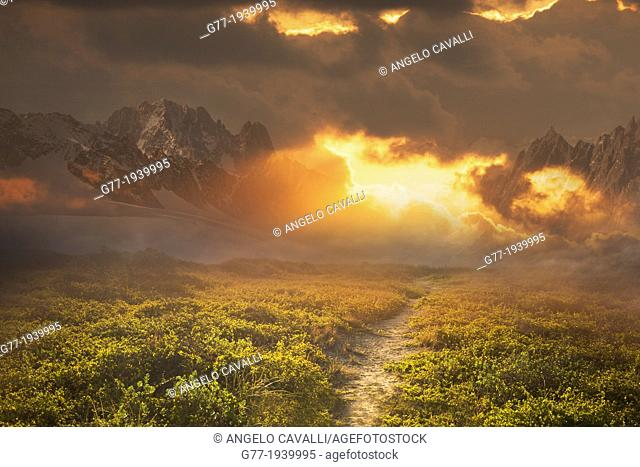 Path to a mountain range at sunset