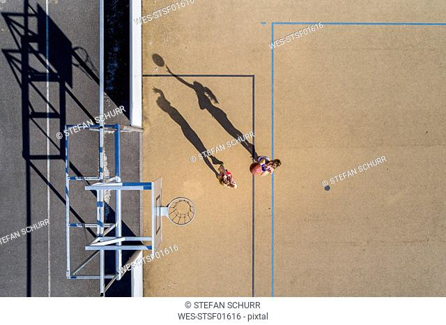 Young women playing basketball, aerial view