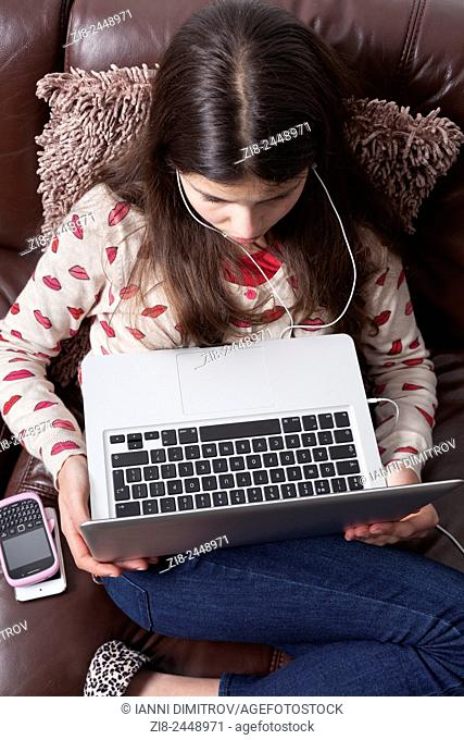 Young girl,12 years old on laptop computer