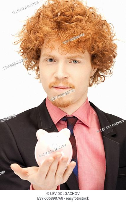picture of handsome man with piggy bank
