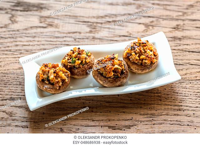 Mushrooms' caps stuffed with mixture of cheese