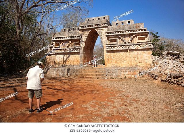 Visitors near the Labna Arch in the Labna Archaeological site, Puuc Route, Merida, Yucatan State, Mexico, Central America