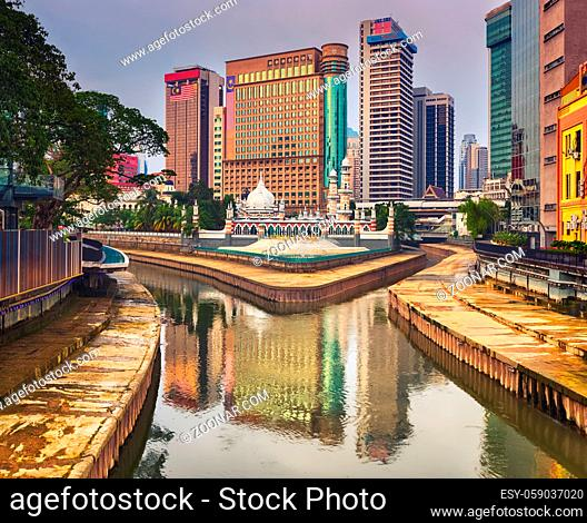 Kuala Lumpur cityscape at sunset, River of the Life on the foreground, Malaysia