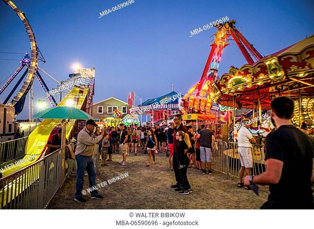 USA, Massachusetts, Cape Ann, Gloucester, St. Peter's Fiesta, Italian-Portuguese fishing community festival, Carnival, dusk