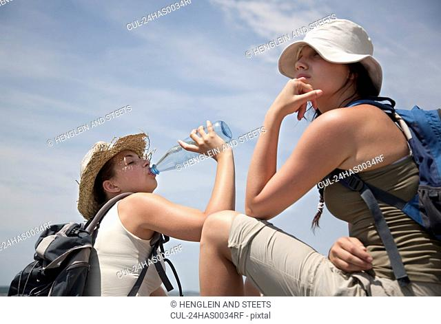 Hikers drinking water