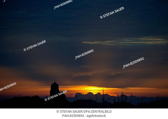 The silhouette of the St. Petri-Kirche (l) church at sunset in Wolgast, Germany, 4 August 2016. PHOTO: STEFAN SAUER   usage worldwide