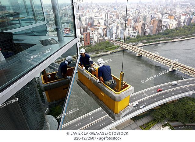 Building maintenance workers, Asahi Beer Tower, Sumidagawa river, Asakusa, Tokyo, Japan