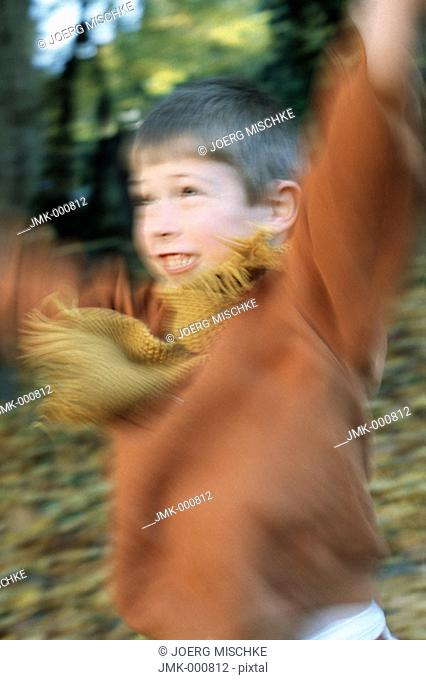 Little boy in the autumnal wood, forest, jumping