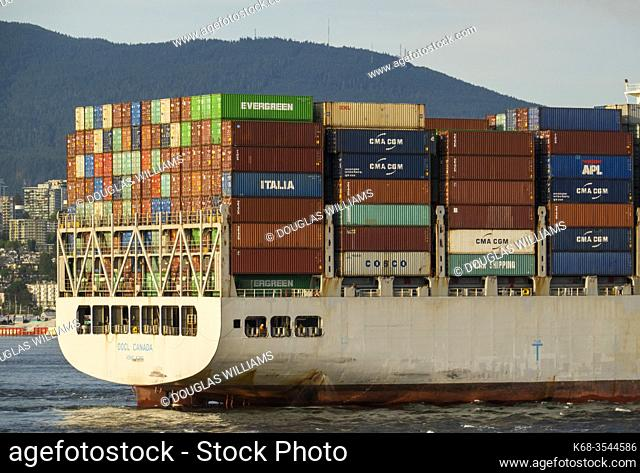 A container ship enters the port of Vancouver in Burrard Inlet, Vancouver, BC, Canada