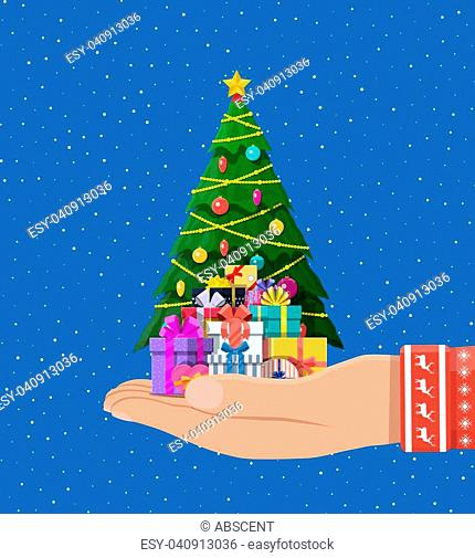 Christmas tree decorated in hand with colorful balls, garland lights, golden star. Lots of gift boxes. Spruce evergreen tree