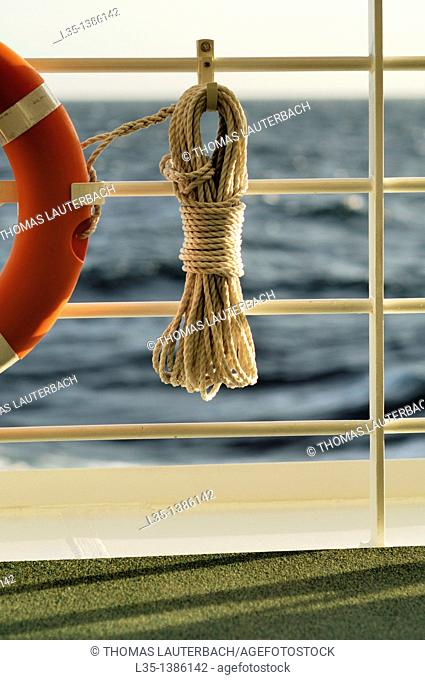 Life ring with rope and the Mediterranean in the background